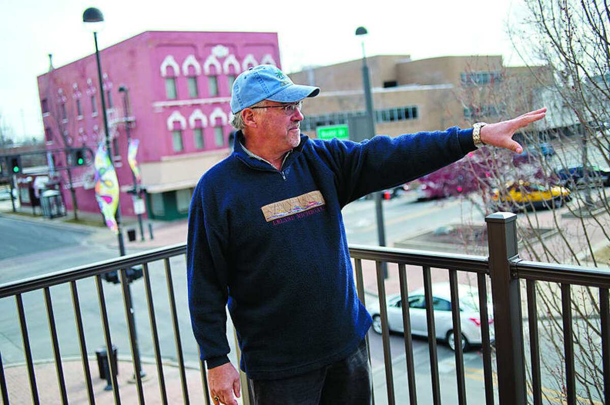 Rick Allen stands on the second-story deck and talks about his renovation of an apartment.