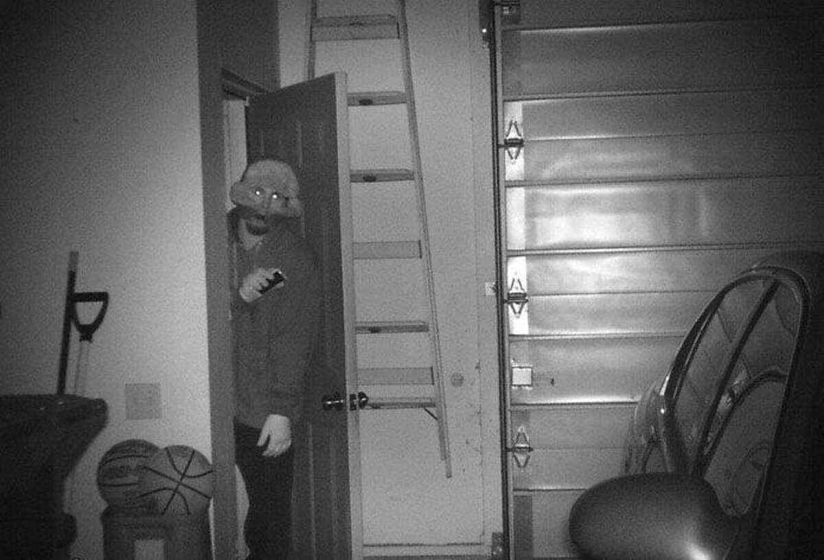 This trail camera image shows the suspect breaking into the garage of a Pineview Drive home.