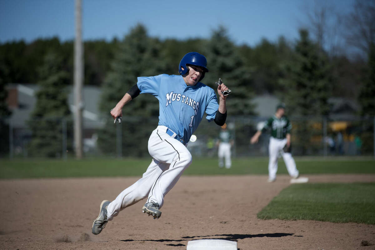 Christian Petre of Meridian rounds third base and runs to home to score a run in Meridian's first game againstClare Tuesday afternoon. Meridian defeated Clare 5-1 in the first game of the double header.