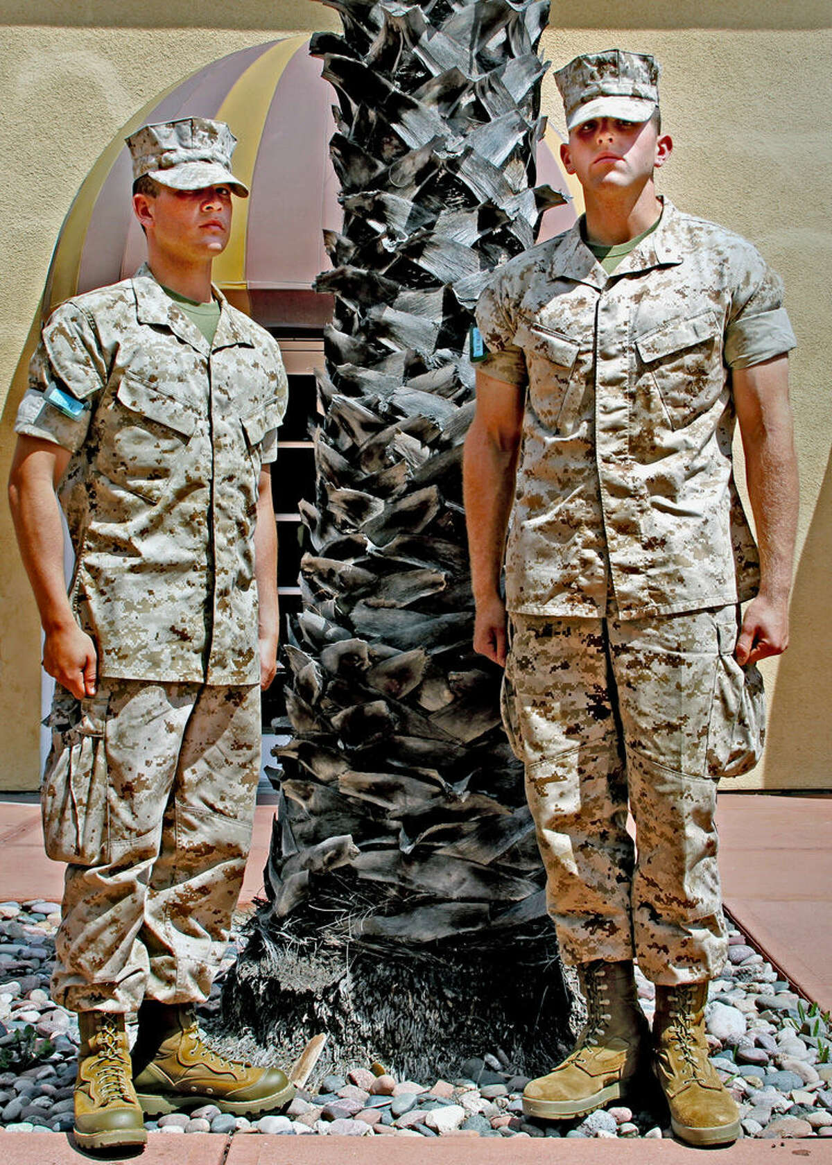 Marine recruit Alan Peck Jr., of Freeland, left, stands with fellow recruit Russell Brown of Bay City.