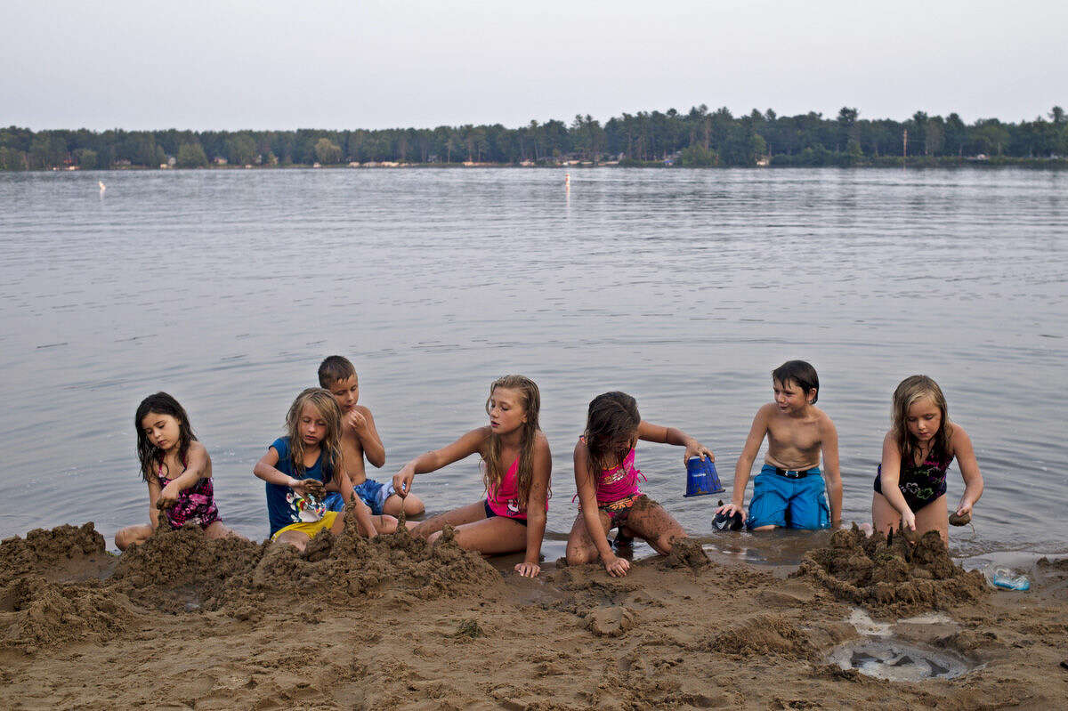 From left: Kaylie Lassen, 6, of Midland, works on her sandcastle as friend Makenzie Cowell, 7, of Sanford, helps cousin Abby Price, 9, of Midland, while Price's brother Garrett Shook, 11, of Midland, looks on as Katlynn Fox, 8, of Midland, creates a new tower as friend Jake Bibea, 10, of Sanford, watches while his sister Lilly Bibea, 6, of Sanford, makes her own fortress on Tuesday at Sanford Lake Park.