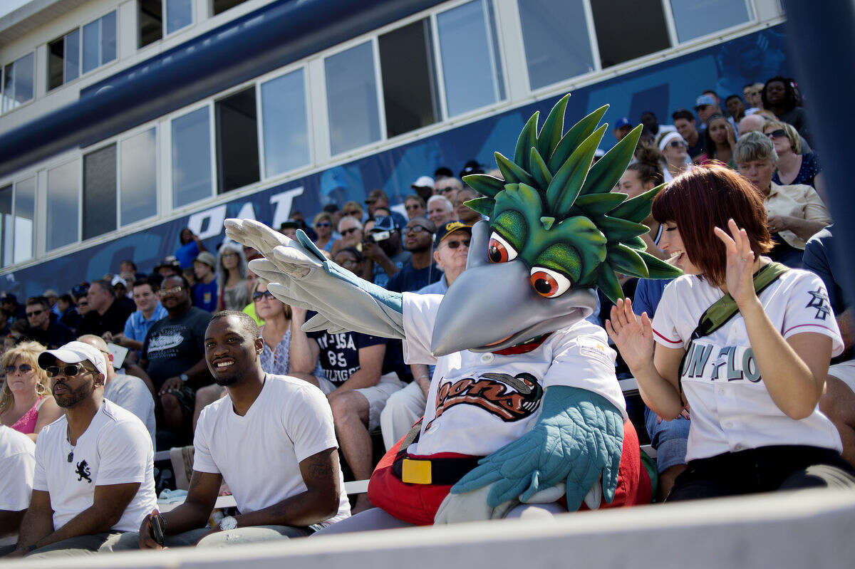 Great Lakes Loons mascot Lou E. Loon dances while sitting in the stands at Northwood's season opener against Northern Michigan during the second quarter on Saturday at Hantz Stadium. The Timberwolves won 20-7.