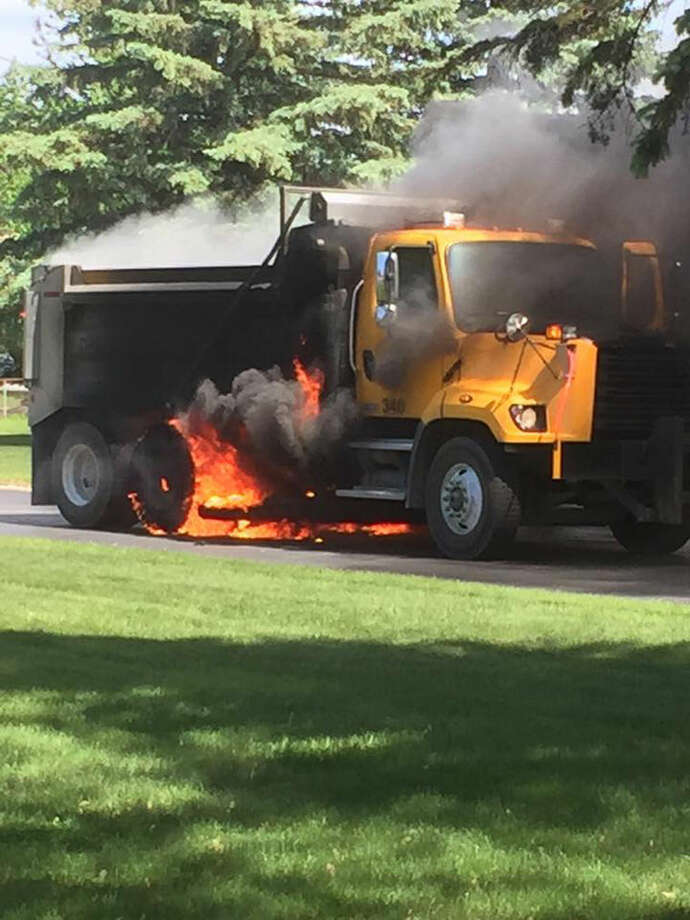 A Daily News Facebook reader took this photo as the city dump truck was burning. Photo: Joan Andy Dellar-Bukowski