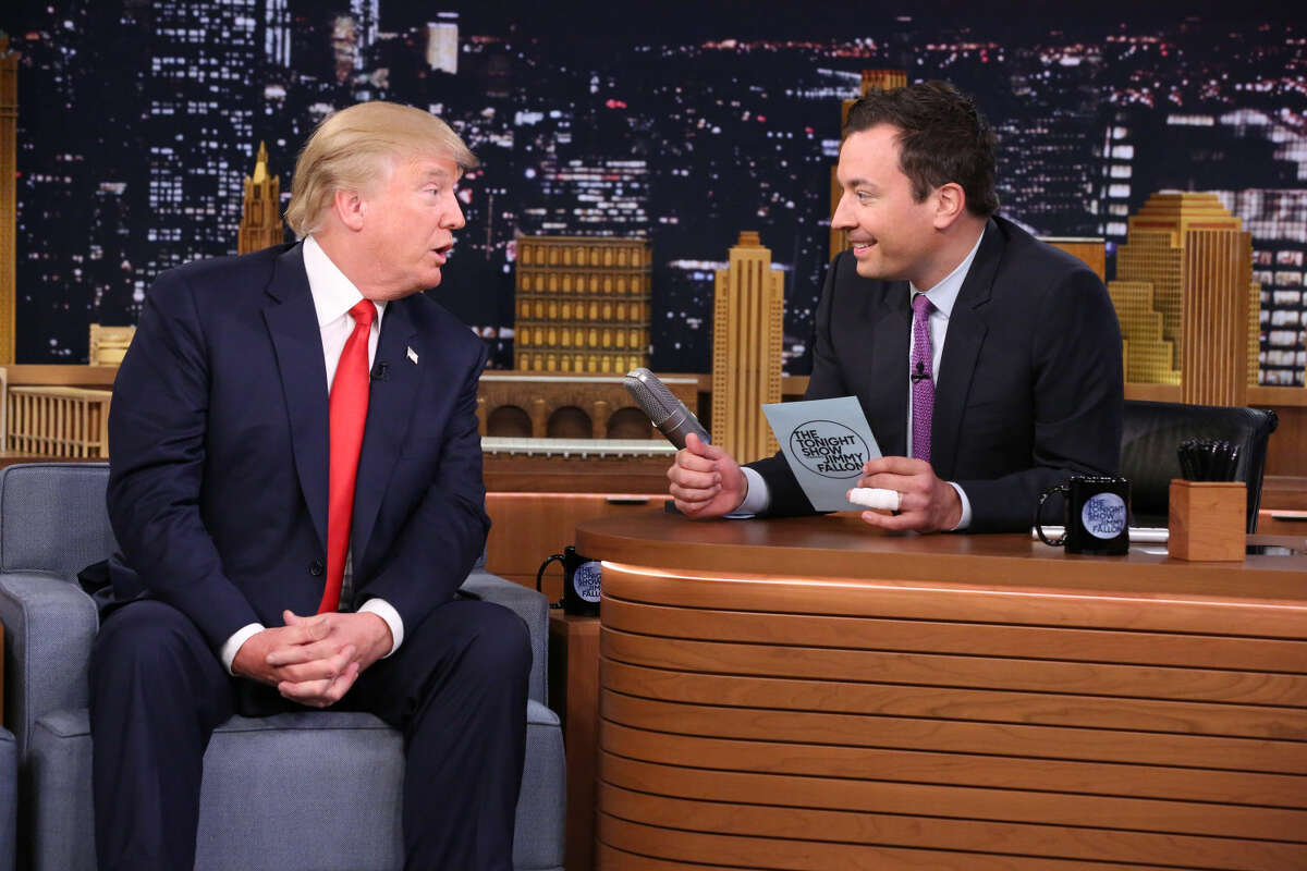 """In this image released by NBC, Republican presidential candidate Donald Trump, left, appears with host Jimmy Fallon during a taping of """"The Tonight Show Starring Jimmy Fallon,"""" on Friday in New York."""