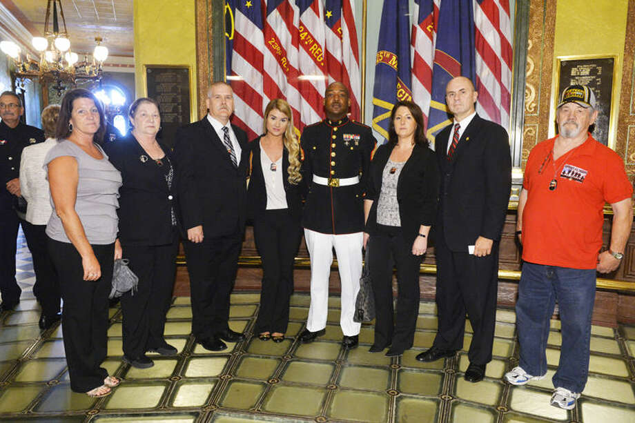 The family of Lance Cpl. Steven Szymanski of Midland met with state Rep. Gary Glenn during a 9/11 Memorial Service on Thursday. From left are Sheri Matthews (aunt); Judy Marcoux (grandmother); John Szymanski (father); Ashlie Szymanski (sister); Casualty Assistance Officer Marine Staff Sgt. Edward Radcliffe; Dawn Szymanski (mother), State Rep. Gary Glenn, and Jim Marcoux (grandfather). Photo:                                 Photo Provided