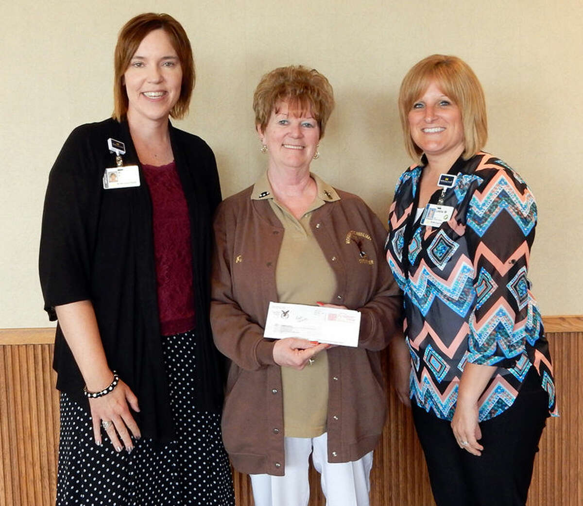 From left are MidMichigan Gladwin Pines Administrator Ruth Benjamin; Pat Murney, president of the Fraternal Order of Eagles Retired Eagles Activity Club; and MidMichigan Gladwin Pines Lead Physical Therapy Assistant Leslie Worden.