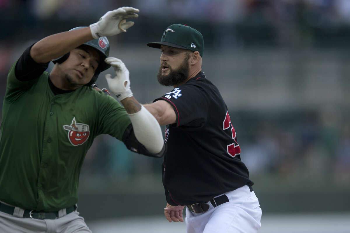 Great Lakes Loons pitcher Yeuri Gonzalez tags out Fort Wayne Tincaps runner Jose Ruiz in the fourth inning of the Loons home game against the Tincaps Thursday evening.