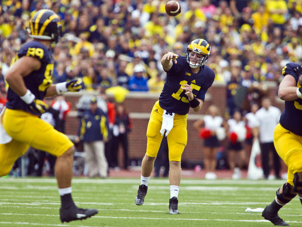 Michigan quarterback Jake Rudock (15) throws a pass towards tight end Ian Bunting (89) in the second quarter of an NCAA college football game against Oregon State in Ann Arbor Saturday.
