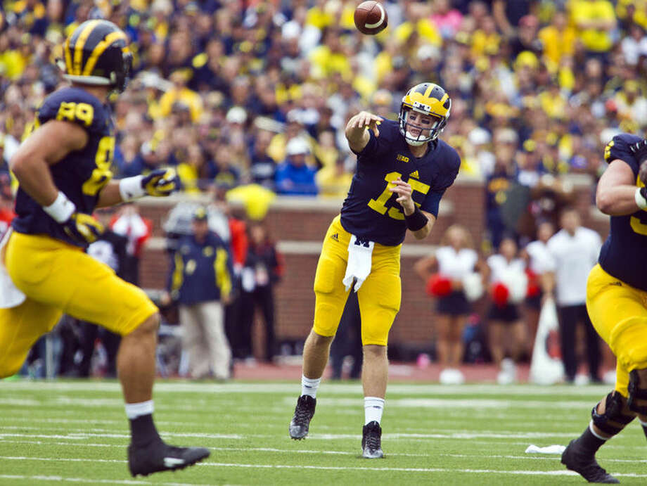 Michigan quarterback Jake Rudock (15) throws a pass towards tight end Ian Bunting (89) in the second quarter of an NCAA college football game against Oregon State in Ann Arbor Saturday. Photo: Tony Ding | AP Photo