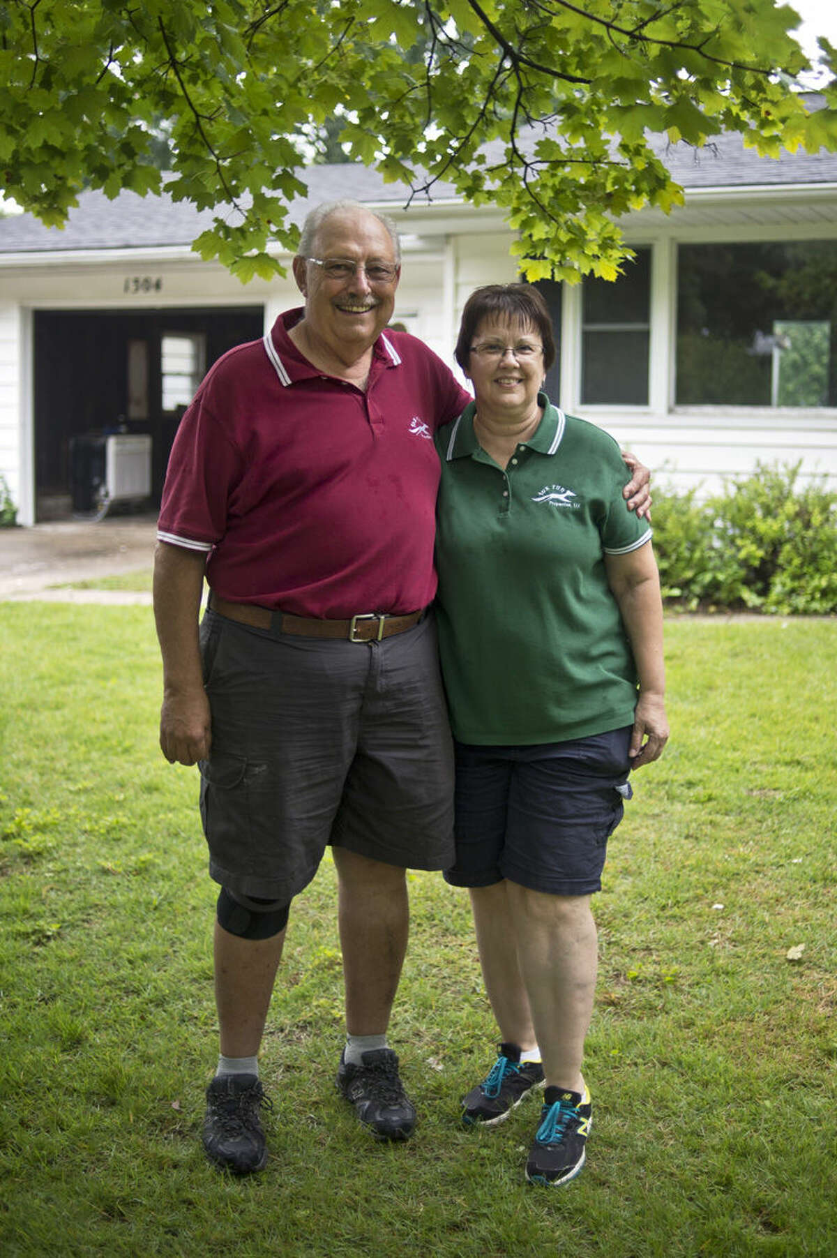 Sanford residents Colette and Philip Urian of Fox Run Properties pose for a portrait outside of a house that they're flipping in Midland. The couple has been flipping houses for 12 years with this property being their 59th.