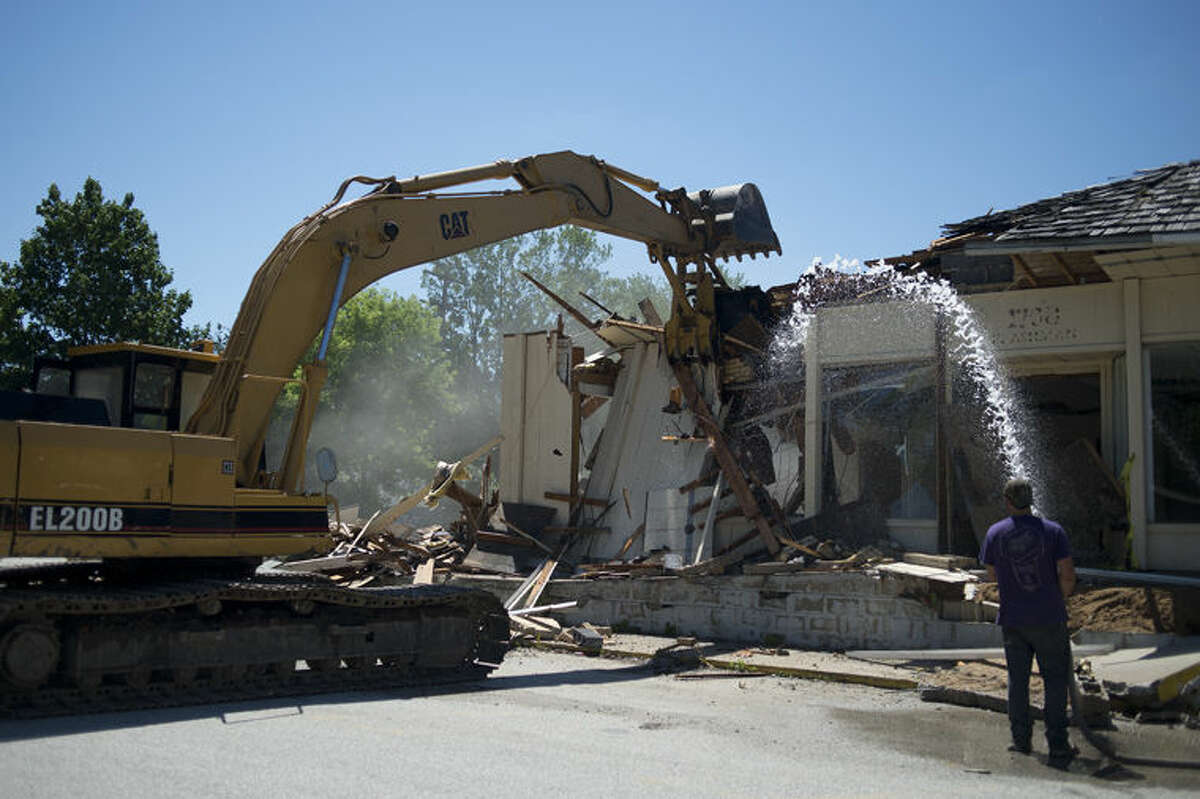 Crews demolish Airport Grocery on the corner of East Ashman Street and Swede Avenue.