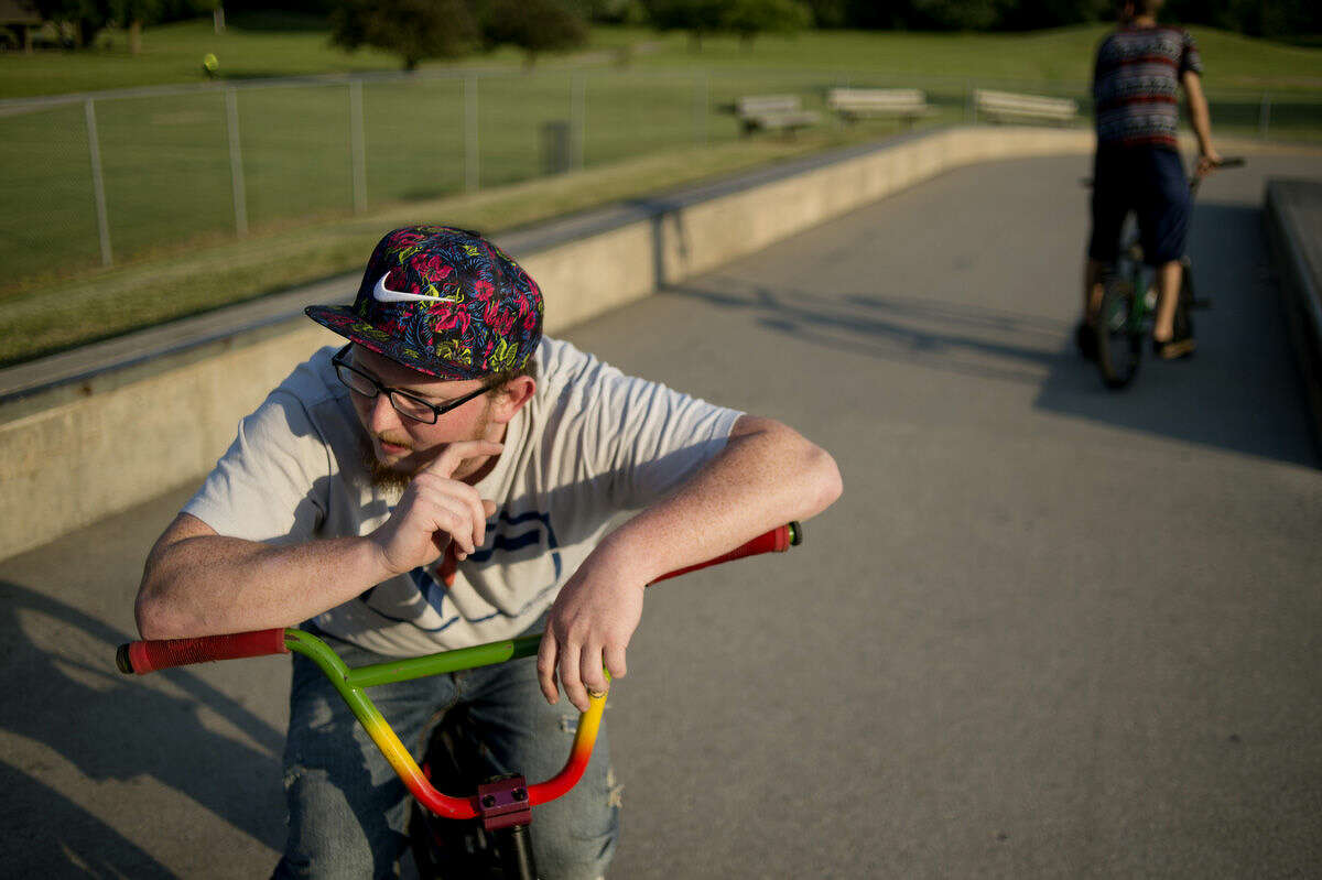 Aaron Phipps of Midland rests between as he rides at Trilogy Skatepark in Midland on Wednesday. The Midland Parks and Recreation Commission has approved use of bikes in the park. Phipps, a longtime rider, has traveled to many skateparks in Michigan and around the country.