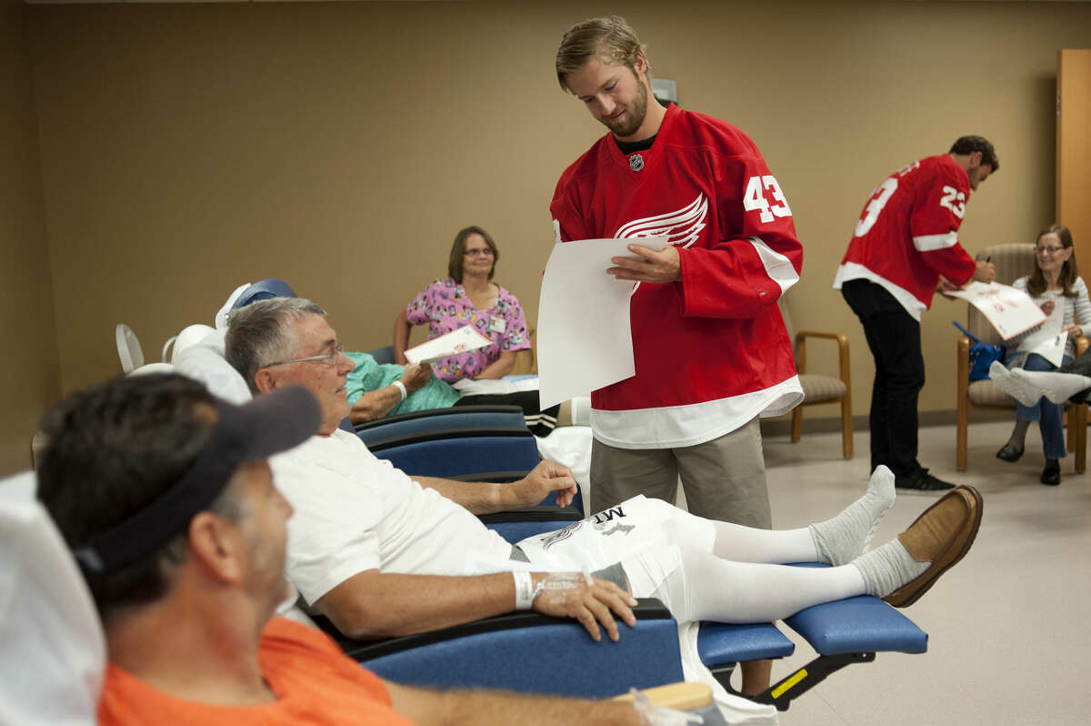 Detroit Red Wings center Darren Helm, left, and defenseman Brian Lashoff sign autographs for patients inside the MidMichigan Medical Center Joint Camp Wednesday morning. Helm, Lashoff, along with Luke Glendening and Riley Sheahan, toured the hospital and visited with patients during the Red Wings seventh annual MI Wings Community Tour.