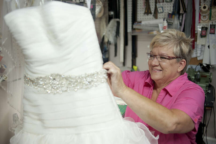 BRITTNEY LOHMILLER | blohmiller@mdn.net Sally Bukoski, owner of Alterations and Custom Sewing, works on a wedding dress at her home sewing studio. Alterations and Custom Sewing won best alteration shop in the Midland Daily New's Reader's Choice awards. Photo: Brittney Lohmiller/Midland Daily News
