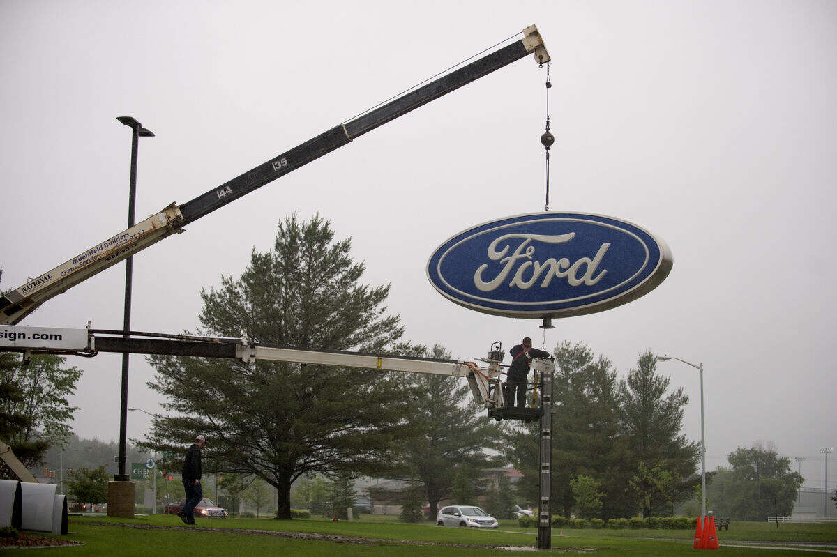 The sign from Midland Ford-Lincoln is moved to its new location on Joe Mann Boulevard by Higher Image Design.