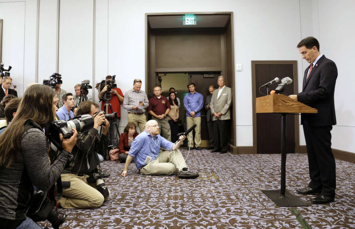 Wisconsin Gov. Scott Walker speaks at a news conference Monday, Sept. 21, 2015, in Madison, Wis., where he announced that he is suspending his Republican presidential campaign. (AP Photo/Morry Gash)