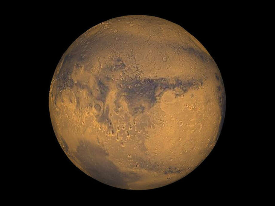 Mars appears to have flowing streams of salty water, at least in the summer, scientists reported Monday in a finding that could have major implications for the possibility of life on the planet Photo: NASA