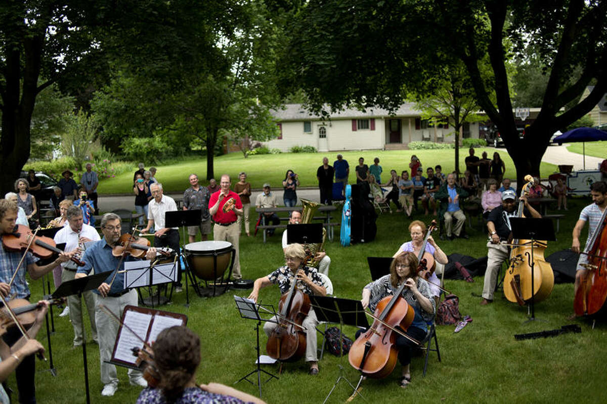 Twenty musicians from the Midland Symphony Orchestra perform on the front lawn on of Etcyl and Ruth Blair's home.