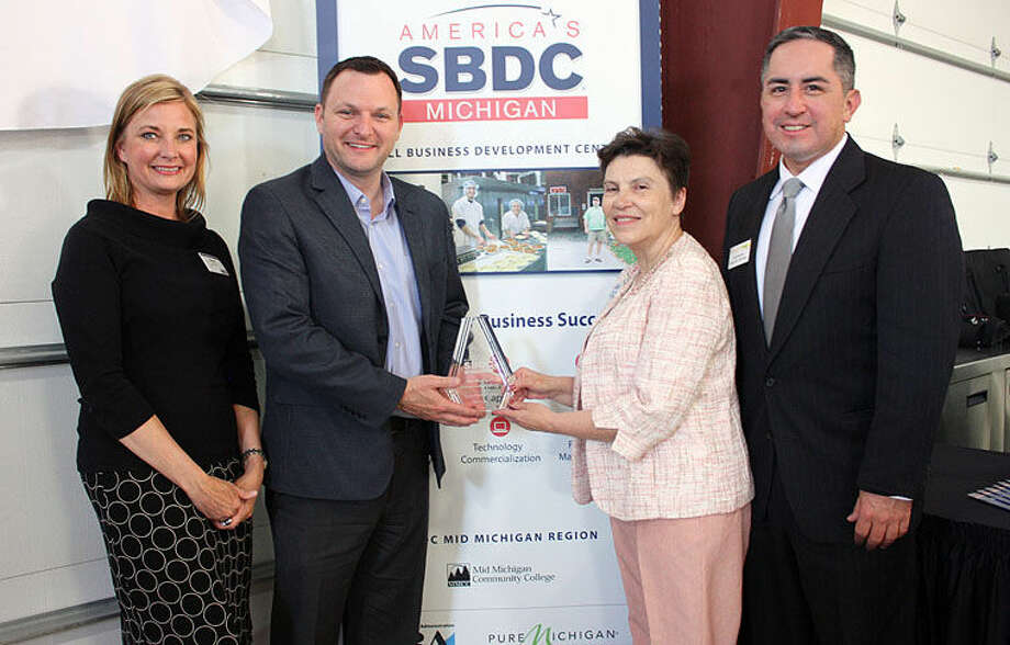 Pictured are, from left, Amy Fisher, SBDC business consultant, Tony Fox, SBDC regional director, Christine Hammond, MMCC president, and Jose Navarrete, SBDC growth consultant. Photo: Photo Provided