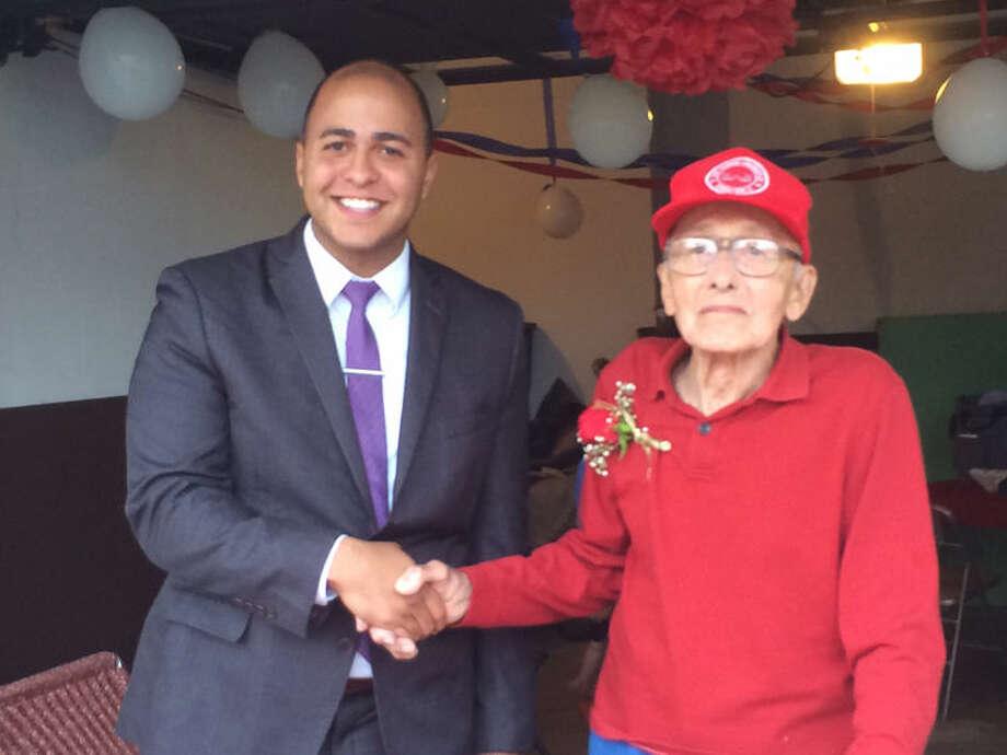 John Richnak with Derrick Mathis, regional representative for Sen. Debbie Stabenow. Photo: Photo Provided