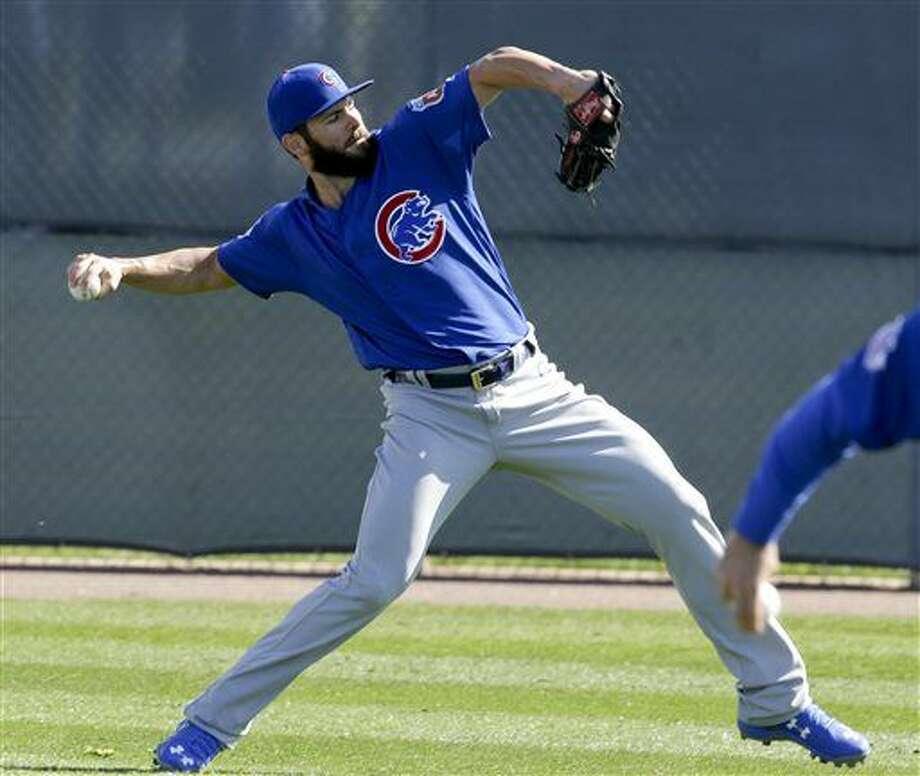 Chicago Cubs starting pitcher Jake Arrieta throws during spring baseball practice in Mesa, Ariz., Saturday, Feb. 20, 2016. (AP Photo/Chris Carlson) Photo: Chris Carlson