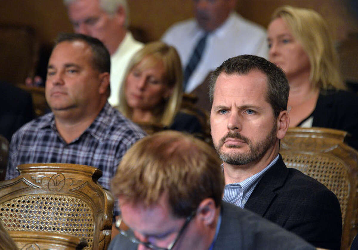 State Rep. Todd Courser, R-Lapeer, listens as an attorney recommends the lawmaker be expelled during a legislative hearing Tuesday in Lansing.