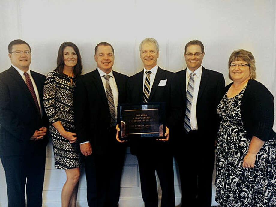 From Wells Fargo Advisors are, from left, Dave Porath, Ashley Methner-Rapanos, Marc Belgiorno, Doak Stolz, David Foster and Jada Davis. Photo: Photo Provided