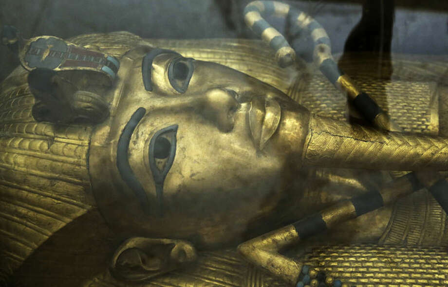 The tomb of King Tut is displayed in a glass case at the Valley of the Kings in Luxor, Egypt, Tuesday, Sept. 29, 2015. Egypt's antiquities minister said King Tut's tomb may contain hidden chambers, lending support to a British Egyptologist's theory that a queen may be buried in the walls of the 3,300 year-old pharaonic mausoleum. (AP Photo/Nariman El-Mofty) Photo: Nariman El-Mofty