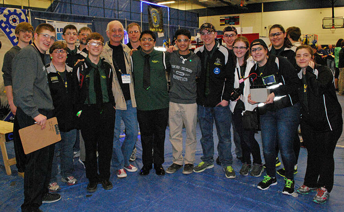 Members of the Dow High Robotics Team 2619, The Charge, meet with Dr. Woodie Flowers, one of the cofounders of FIRST, at the Waterford FIRST Robotics District Competition.