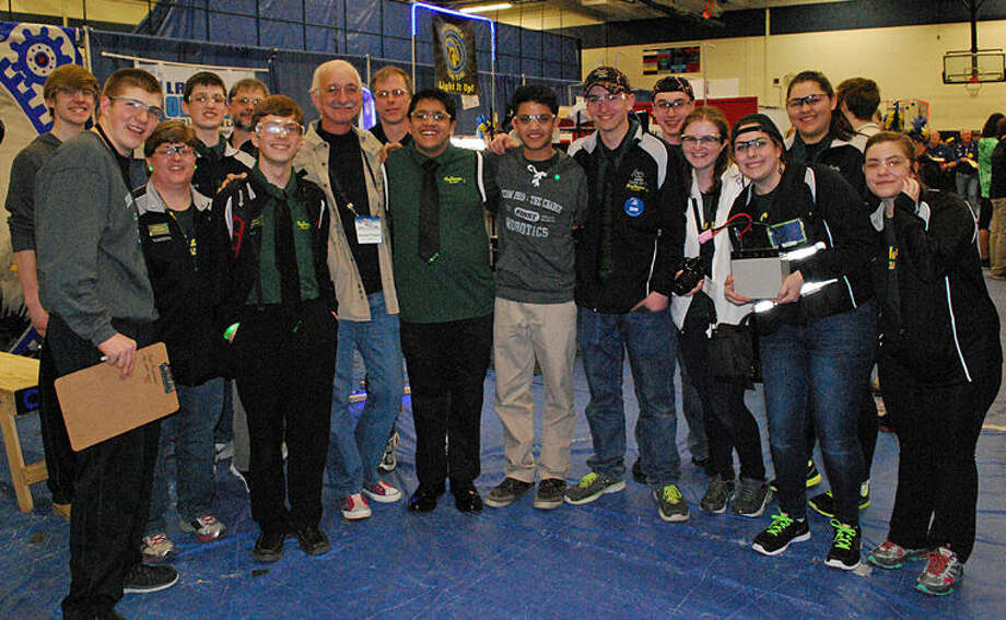 Members of the Dow High Robotics Team 2619, The Charge, meet with Dr. Woodie Flowers, one of the cofounders of FIRST, at the Waterford FIRST Robotics District Competition. Photo: Photo Provided