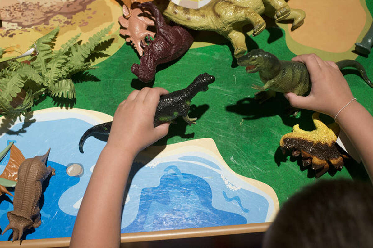 BRITTNEY LOHMILLER | blohmiller@mdn.net Dominic Rupp, 8, of Bay City plays with miniature toy dinosaurs in the Be the Dinosaur: Life in the Cretaceous exhibit at the Midland Center for the Arts. Be the Dinosaur is open from June 6 to September 3.