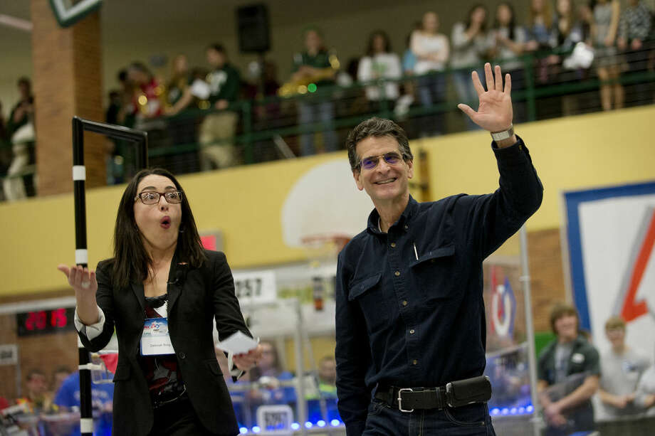 Dean Kamen, founder of FIRST, waves as Deborah Borg, president, Dow USA, pumps up the crowd at the Great Lakes Bay Region FIRST Robotics District Competition at H.H. Dow High School before the announcement that Dow Chemical is becoming a strategic partner with FIRST. Dow has made a $1 million commitment to FIRST over the next two years. Photo: Neil Blake/Midland Daily News