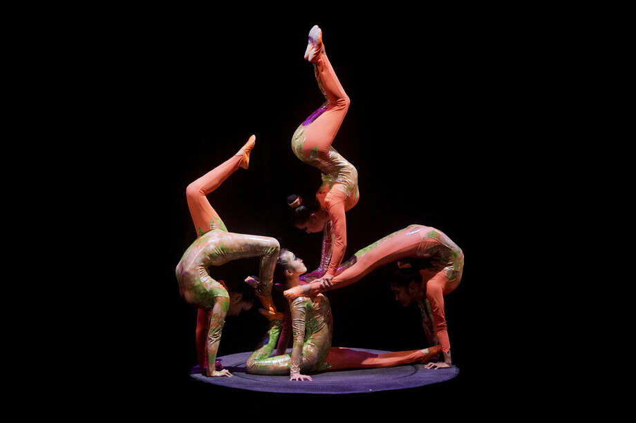 Chinese athletes from the Golden Dragon Acrobats perform at the Midland Center for the Arts on Tuesday. The company has been performing continuously since 1978. The performance combines traditional dance and costumes with acrobatics and feats of strength. Photo: Neil Blake   Nblake@mdn.net