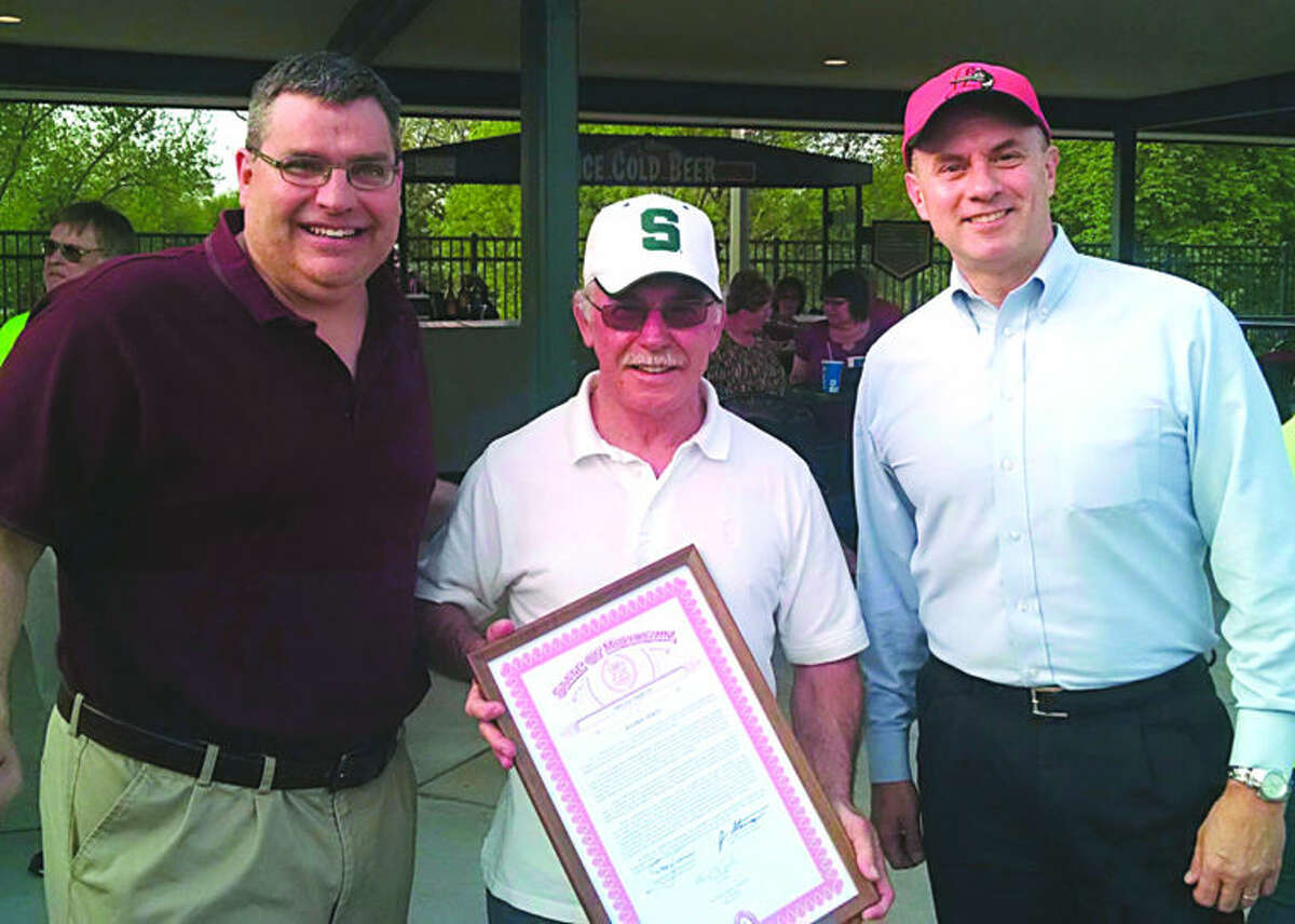 Former Midland Daily News Managing Editor Ralph E. Wirtz, center, was honored at his retirement party recently at Dow Diamond with a tribute to his decades of community service signed by Gov. Rick Snyder; state Sen. Jim Stamas, R-Midland; and state Rep. Gary Glenn, R-Midland. The tribute was presented by Stamas' brother, former state Sen. Tony Stamas, left, and Glenn, right.
