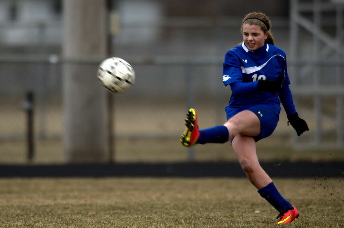 BRITTNEY LOHMILLER | blohmiller@mdn.net Isabelle Sommerer of Gladwin kicks the ball in the first half of the girls soccer game against Bullock Creek Thursday evening. Gladwin defeated Bullock Creek 5-4.
