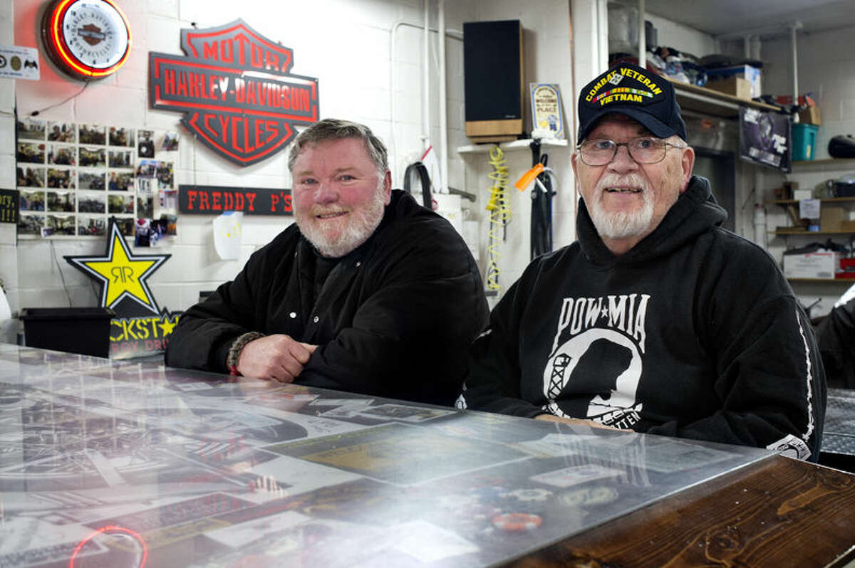 Tom Talbot, left, of Midland, and American Legion 10th District commander Kenny Burtch are in charge of the Midland Area Vet-2-Vet peer support group. Vets from any era, combat or noncombat, are welcome to the once a month meetings held at Freddy P's. The group is looking to get the word out and grow membership.