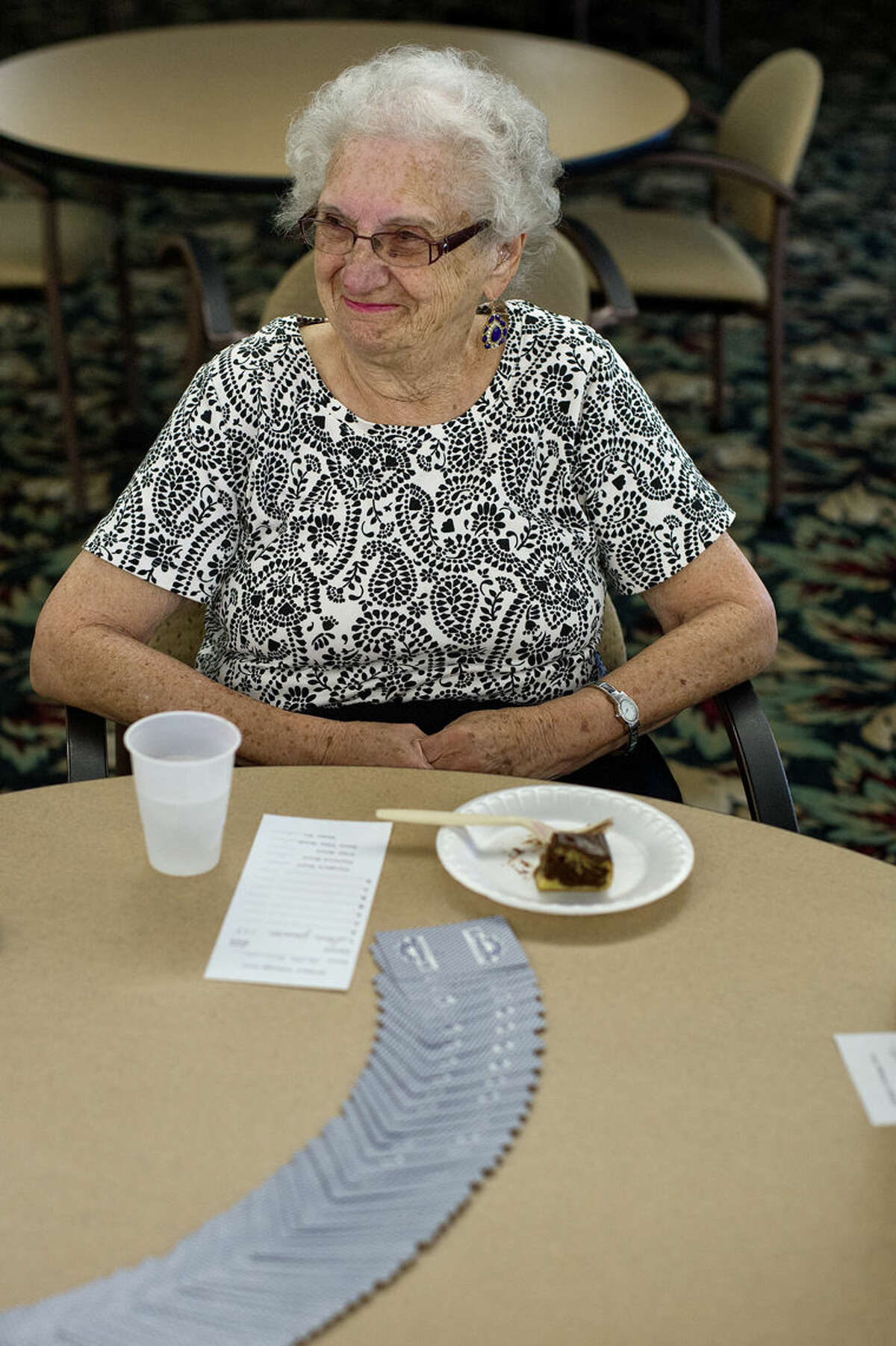 Ruth Emerson enjoys a piece of cake while waiting for her next cribbage match in the dining room at Washington Woods.