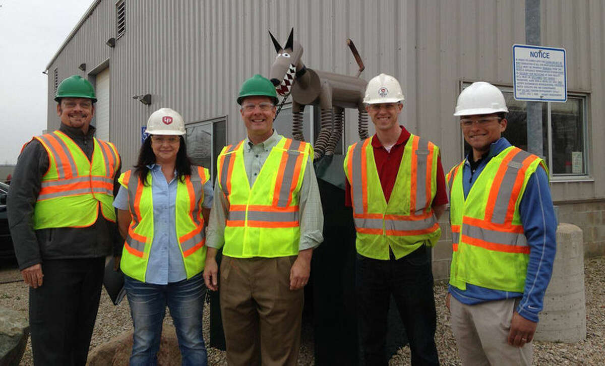 U.S. Rep. John Moolenaar, center, is shown with staff at PADNOS Central Michigan in Alma after he toured the facility. Pictured, from left, are: Roger Simon, account executive, Amanda Radosa, manager of PADNOS Central Michigan, Moolenaar, Karl Marcusse, district manager, and Sam Padnos, management.