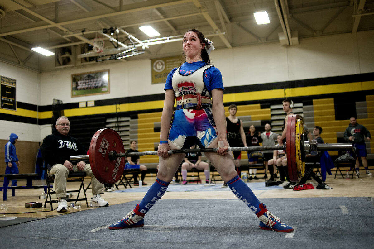 Gina Hensley deadlifts 352.7 pounds during the Michigan USA Powerlifting meet on Saturday as part of the ABBRx Natural and Fit Day at Bullock Creek High School. Hensley was the overall winner in the female open division.