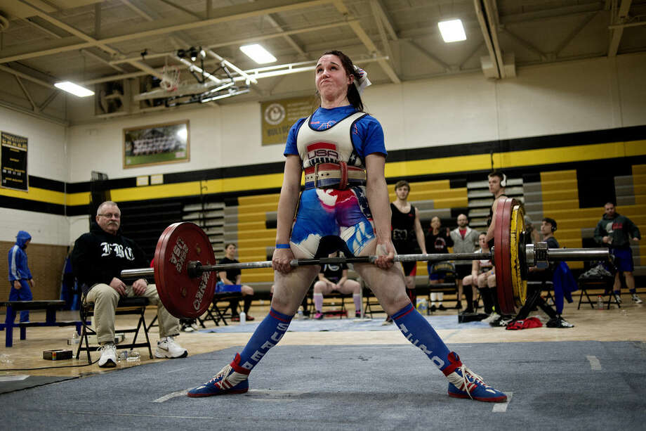 Gina Hensley deadlifts 352.7 pounds during the Michigan USA Powerlifting meet on Saturday as part of the ABBRx Natural and Fit Day at Bullock Creek High School. Hensley was the overall winner in the female open division. Photo: NICK KING | Nking@mdn.net