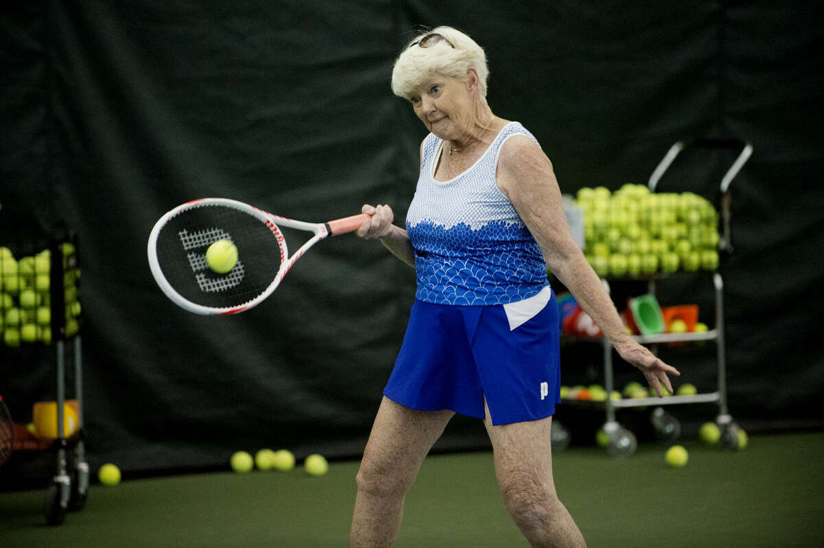 """NEIL BLAKE   nblake@mdn.net Judi Wills of New York participates in the Gram Slam Camp at the Greater Midland Tennis Center on Friday. The camp, which started Tuesday and ended Friday, was for women 55 and over and brought together tennis enthusiasts from the Midwest and beyond. Carol Gassell, Tennis Center Executive Director Mike Woody's mother, had the idea to hold the camp. """"It's worth every penny,"""" Wills said. """"I'm having a blast."""""""