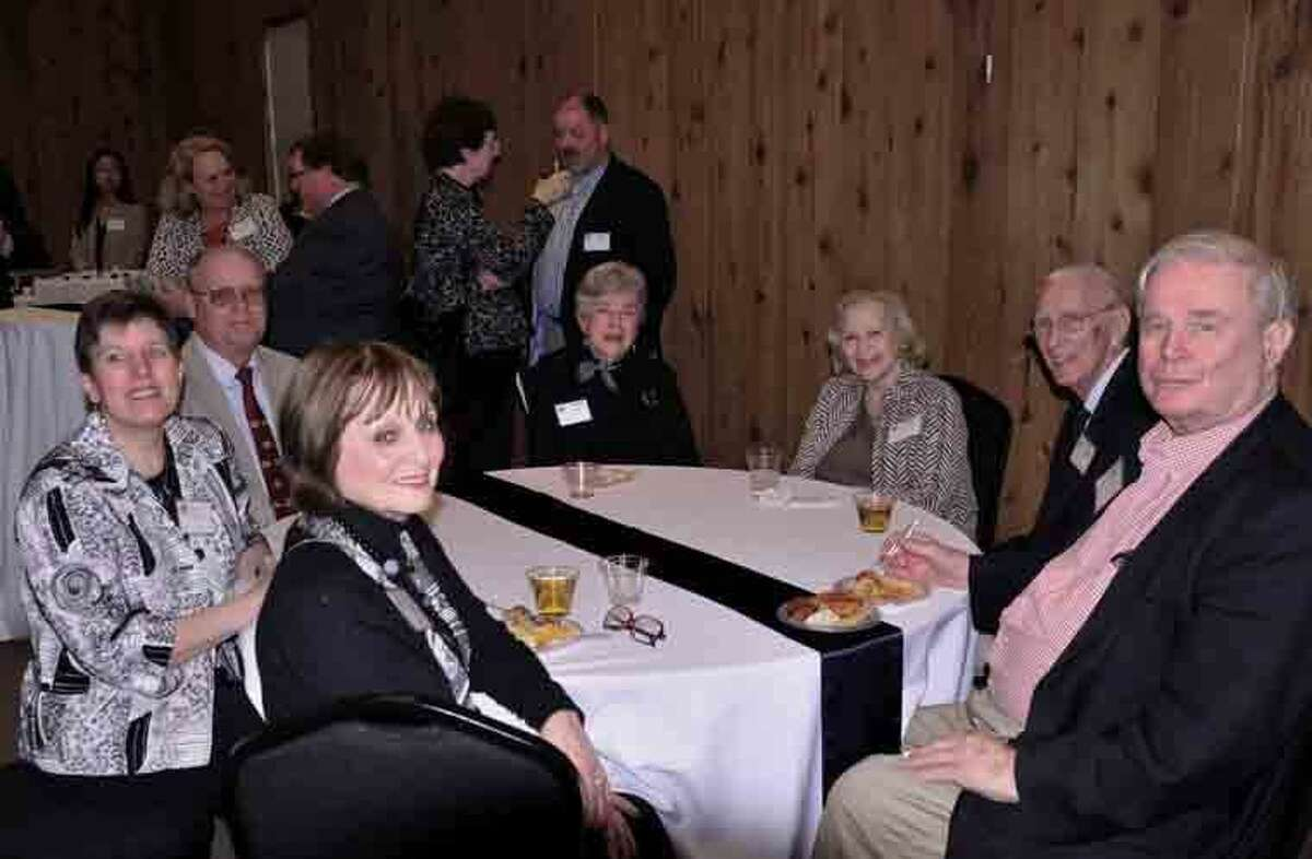 Shown at the opening reception are the people who opened their homes for tours during the conference, from left, Kris Hallett, Glenn Hallett, Nancy Barker, Christine Lane, Arlene Thompson, Ross Thompson and Bill Barker at the Carriage House Hall at the Bradley House Museum.