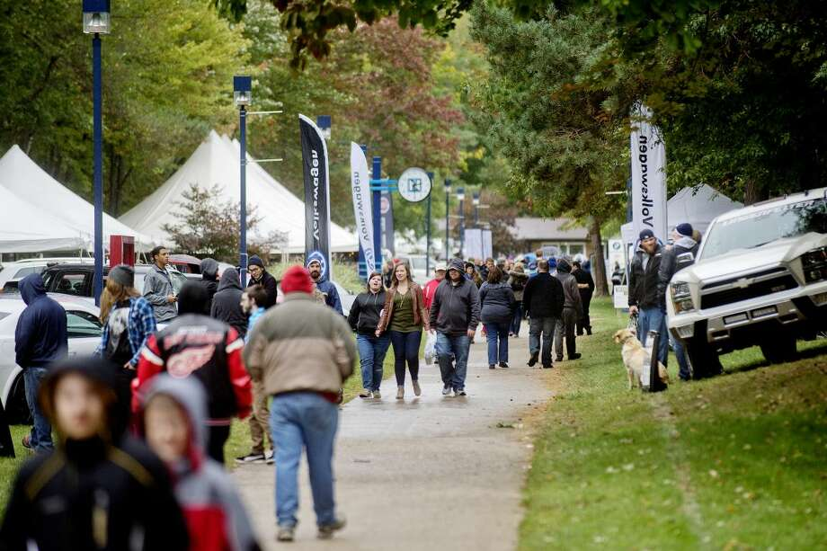 Patrons walk the grounds during the Northwood University International Auto Show in this Daily News file photo. This year's show is planned from noon to 6 p.m. Sept. 30; 9 a.m. to 6 p.m. Oct. 1; and 10 a.m. to 5 p.m. Oct. 2. Photo: Daily News File Photo