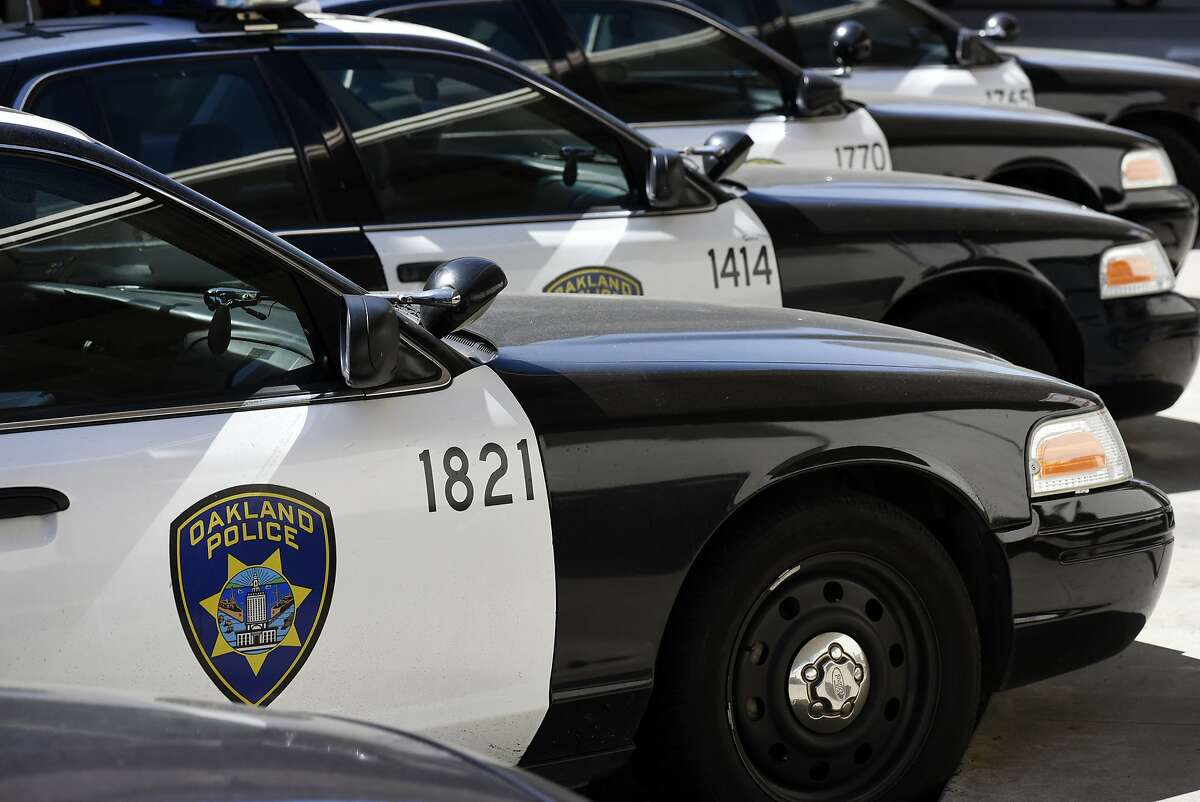 A line of police cruisers are seen in the depot at the Oakland Police Department in Oakland, CA.