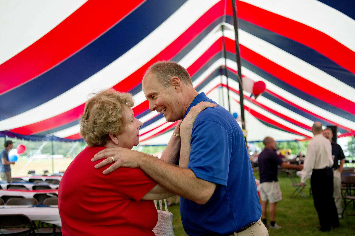 U.S. Rep. John Moolenaar, R-Midland, hugs long-time friend Fran Hunt during his Picnic at the Tridge on Monday. Guests enjoyed a meal, games and carnival treats.