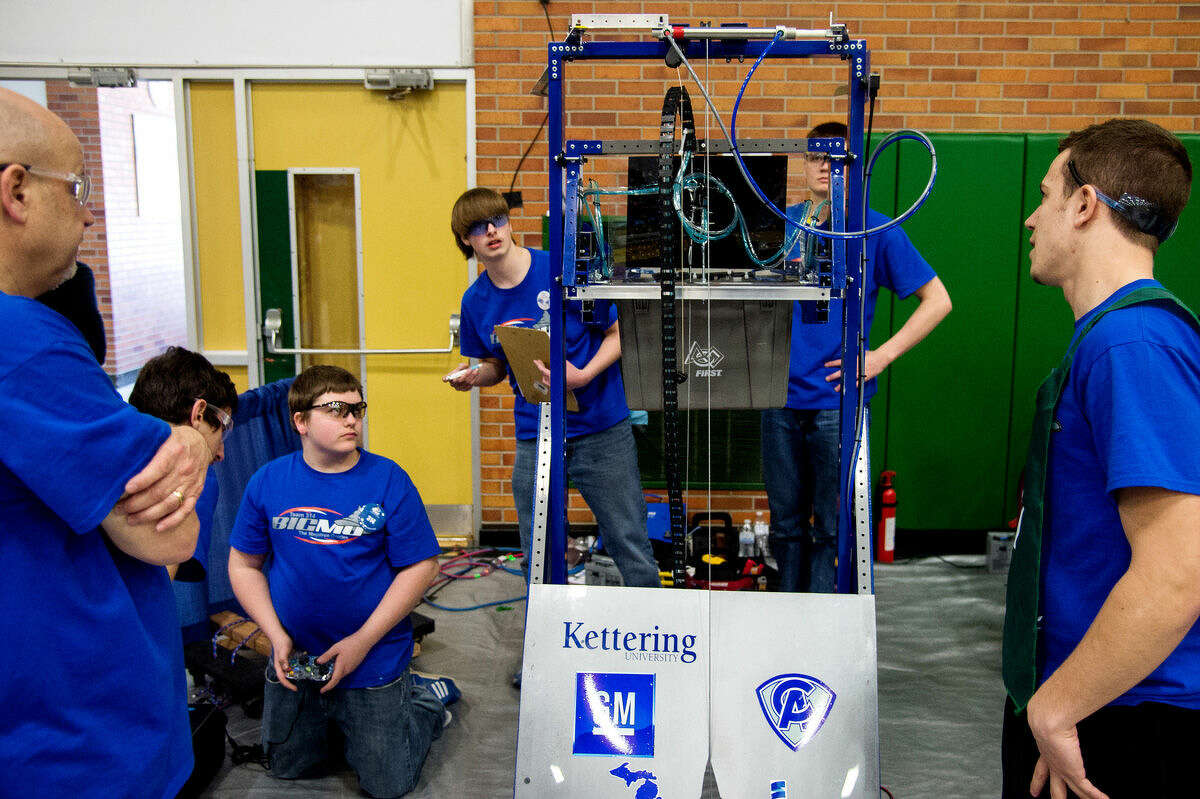 Team Big MO, of Flint, inspects its robot between competitions during the Great Lakes Bay Region Robotics District Competition at H.H. Dow High School on Saturday in Midland. Big MO was seeded first after the qualifying rounds, and choose The Charge has one of the teams for its Alliance.