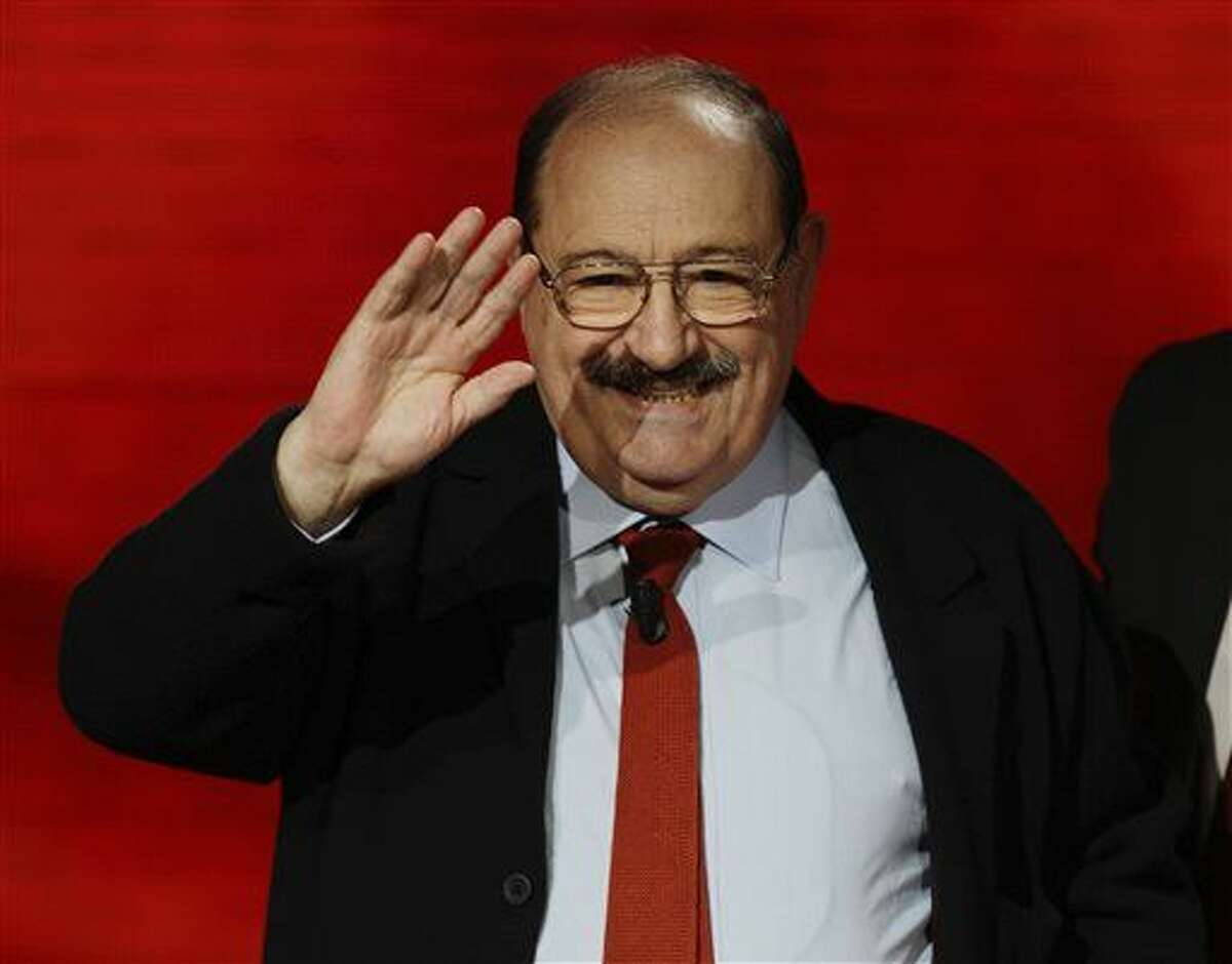 """FILE - In a Sunday, Oct.31, 2010 file photo, Italian writer, medievalist, semiotician, philosopher, literary critic and novelists Umberto Eco waves to public during the Italian State RAI TV program in Milan, Italy. Eco, best known for the international best-seller """"The Name of the Rose,"""" died Friday, Feb. 19, 2016, according to spokeswoman Lori Glazer of Eco's American publisher, Houghton Mifflin Harcourt. He was 84. (AP Photo/Luca Bruno, File)"""