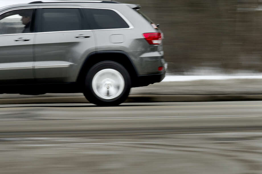 A motorist drives north along Eastman Road between Jerome Street and Saginaw Road in Midland. Photo: NICK KING   Nking@mdn.net