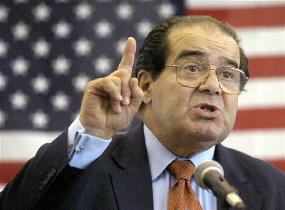FILE - In this Wednesday, April 7, 2004 file photo, U.S. Supreme Court Justice Antonin Scalia speaks to Presbyterian Christian High School students in Hattiesburg, Miss. On Saturday, Feb. 13, 2016, the U.S. Marshals Service confirmed that Scalia has died at the age of 79. (Gavin Averill/The Hattiesburg American via AP)