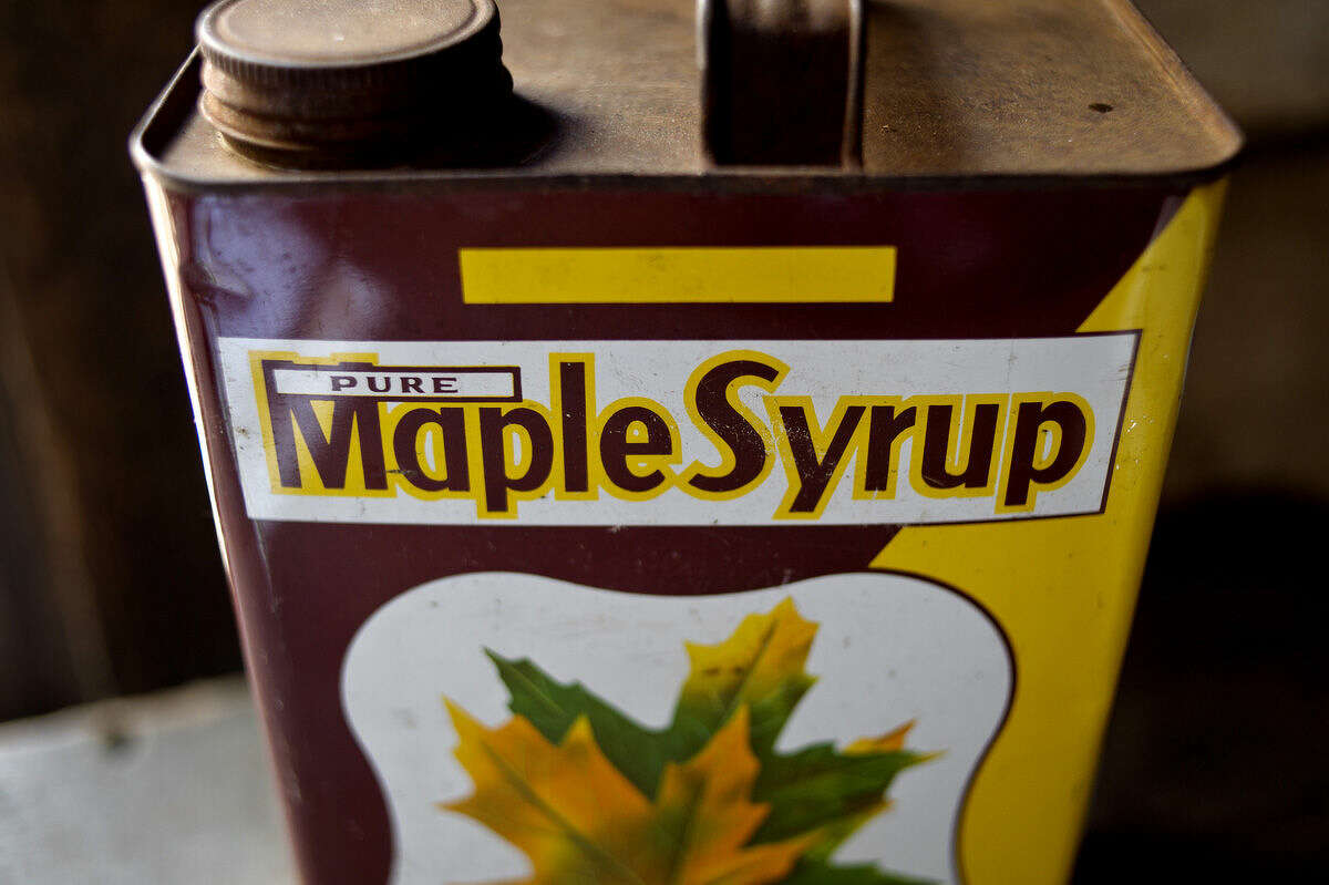 An old maple syrup can is on display inside the sugarhouse during Maple Syrup Day on Saturday at the Chippewa Nature Center. The festival featured a pancake meal with real maple syrup, kids' maple games, hay rides to the sugarhouse and educational stations with lessons on syrup making through the years.
